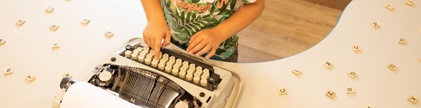 little hands typing on typewriter