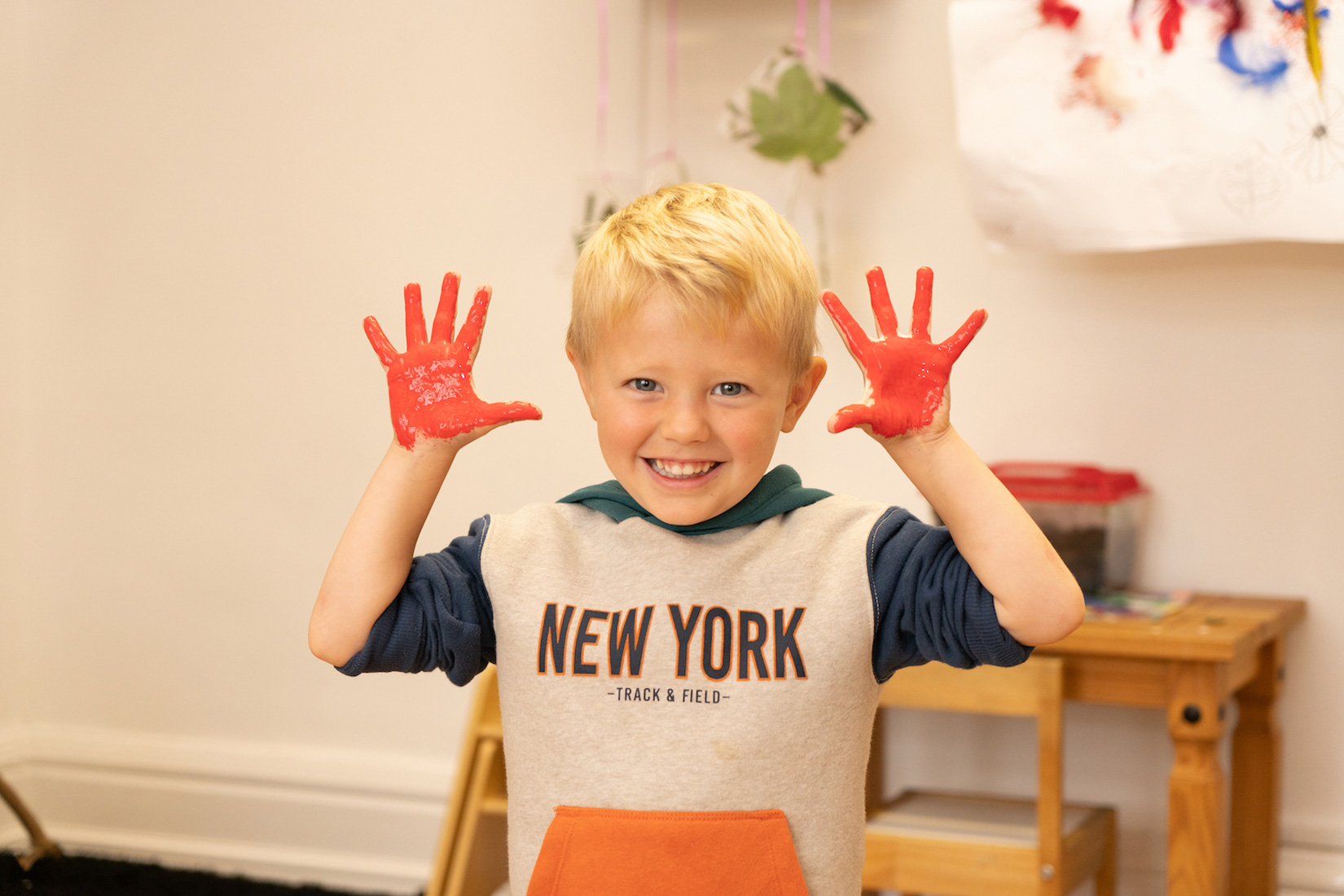 Little Hands childcare boy with paint on his hands
